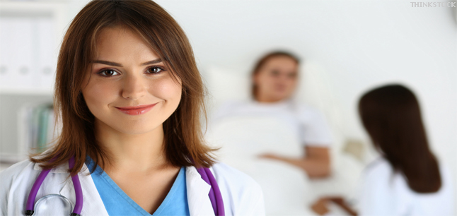 Female medicine doctor in front of patient in bed