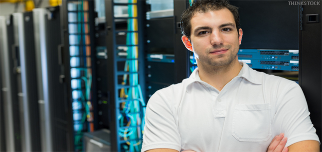 A datacenter manager in front of the datacenter equipment racks